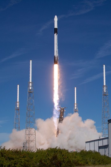 Photograph of a Falcon 9 booster landing on LZ-1